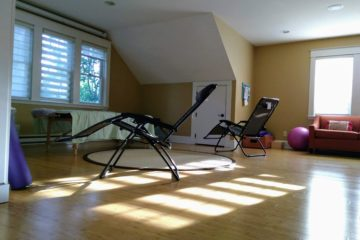 Sunshine on the yoga studio floor at the end of a day of community acupuncture.