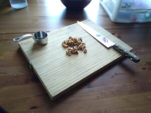 chopping walnuts for baked pears and honey